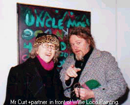 Mr Curt and wife in front of Willie Loco painting.